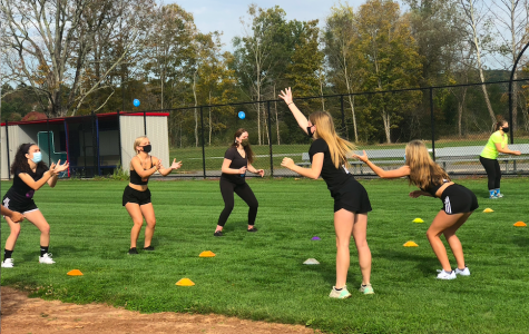 Nonnewaug seniors demonstrate teamwork skills during the water balloon toss at Senior Field Day 2020.