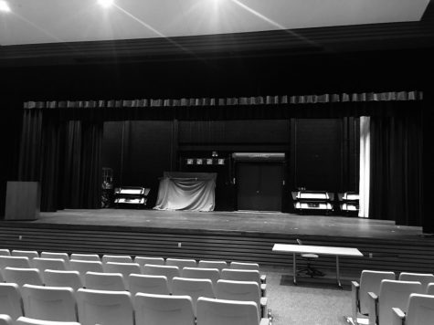 A black & white photograph of the empty stage at Nonnewaug High School. After Shrek the Musical was canceled last spring due to the Coronavirus pandemic, the seniors involved in last year