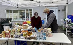 Volunteers prepare to serve clients outside the food bank. The Woodbury Food Bank, October 3, 2020, 8:49 a.m., (from left to right) Tony Mongillo and Mark Vaghi.