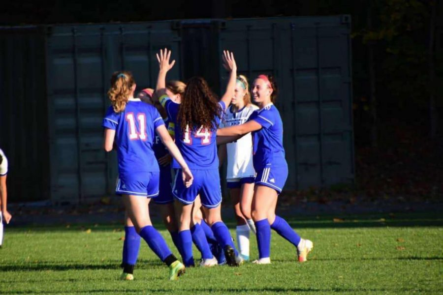 From Left to Right: Ella Lupo, Grace Koukopoulos, and Skyla Starziski celebrating a goal against Litchfield  on October 6, 2020