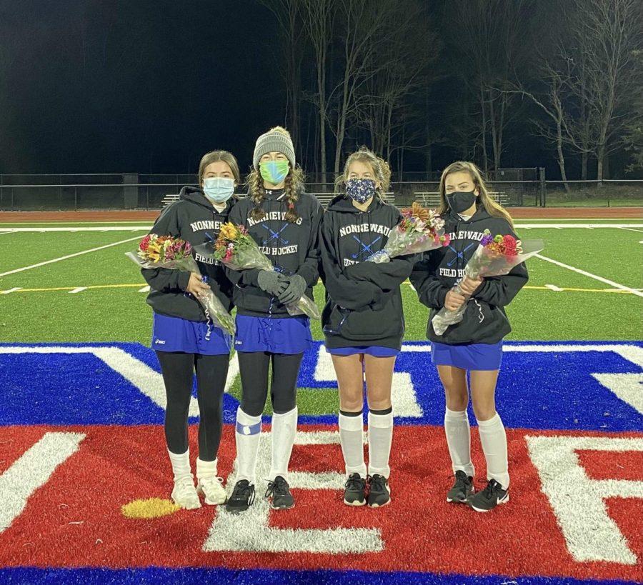 Nonnewaug senior field hockey players Victoria Canonico, Stephanie DiSarro, Lola Taylor, and Isabella Calvano pose on senior night Nov. 2.