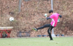 Nonnewaug boys soccer goalie Dylan Chung punts the ball after making a save during a game earlier this season. It was Chung's first season with the Chiefs after transferring from Canterbury.