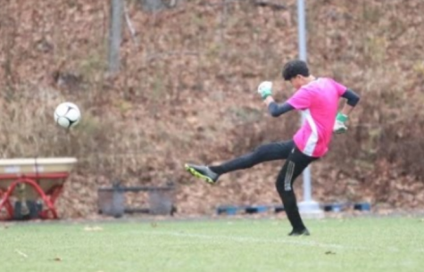 Nonnewaug boys soccer goalie Dylan Chung punts the ball after making a save during a game earlier this season. It was Chung