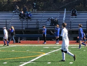 The bleachers at Nonnewaug's turf field were sparsely populated with fans this fall, as shown at a boys soccer game in October.