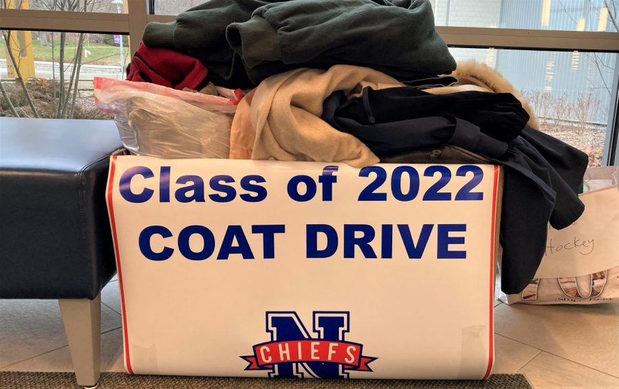 Coats+fill+a+donation+box+for+the+NHS+Class+of+2022%27s+coat+drive%2C+which+runs+through+Dec.+18.