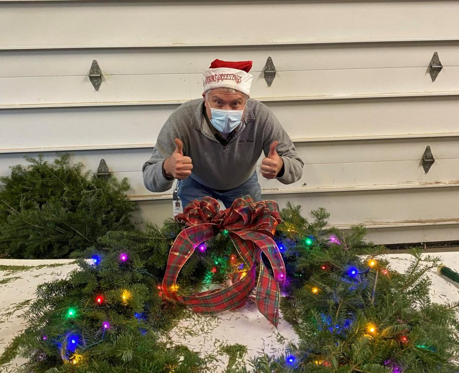 Eric+Birkenberger+shows+his+approval+after+finishing+the+decorations+for+one+of+the+wreaths+sold+at+the+Woodbury+FFA+holiday+plant+sale.