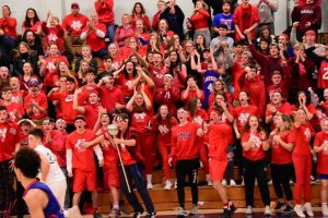 Nonnewaug students and parents cheer on the Chiefs during the second game of a girls-boys basketball doubleheader at Shepaug last winter. An emphasis on
