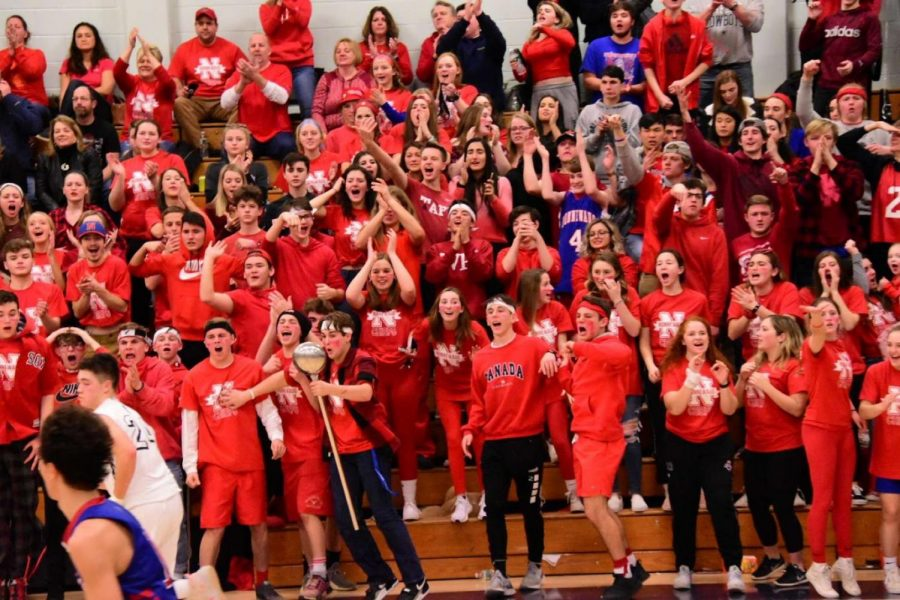 Nonnewaug+students+and+parents+cheer+on+the+Chiefs+during+the+second+game+of+a+girls-boys+basketball+doubleheader+at+Shepaug+last+winter.+An+emphasis+on+%22Pride+in+the+Tribe%22+resulted+in+electric+atmospheres+like+these%2C+but+fans+are+unlikely+to+be+allowed+if+there+is+a+basketball+season+this+winter.