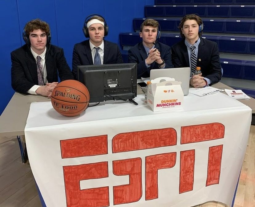 From left, Travis Bambino, Ryan Blanchard, Austin Bedard, and Gabe Brochu celebrated the boys basketball team's senior night last winter by posing as ESPN broadcasters.