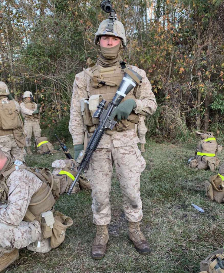 Jack Cronin, a 2020 Nonnewaug graduate, prepares his weapon for shooting qualifications last year at Camp Lejeune, North Carolina. Cronin is a combat engineer who enlisted for four years of active duty with the U.S. Marines.