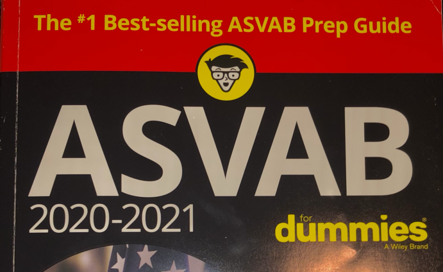Jack Cronin, a 2020 Nonnewaug graduate and U.S. Marine, recommends that students who are considering joining the military after high school study for the ASVAB with a book like this one.