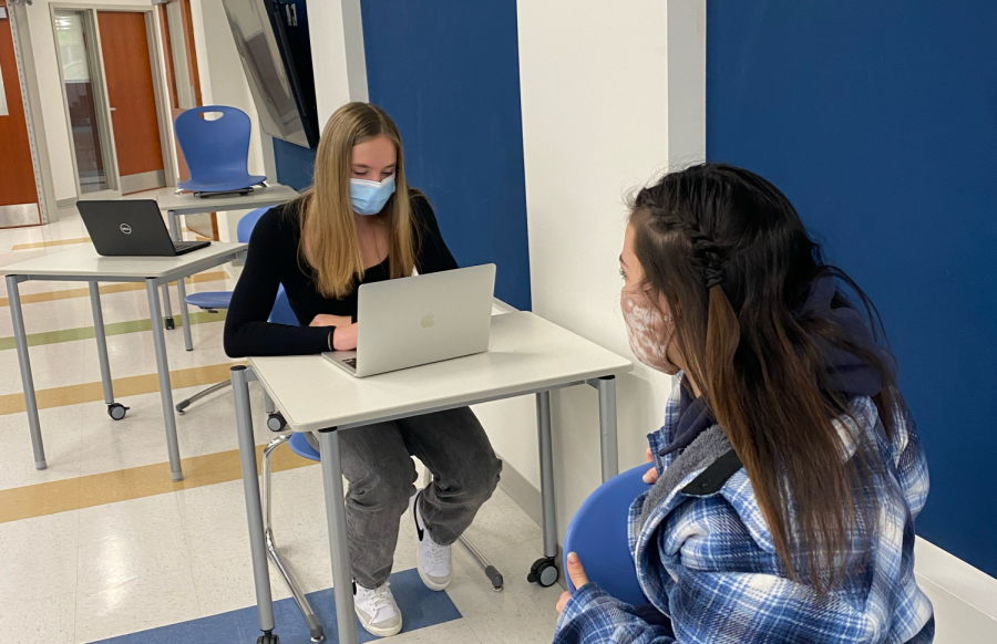 Samantha+Thompson%2C+left%2C+and+Isabella+Calvano+converse+about+making+college+decisions+in+study+hall+Jan.+21%2C+two+days+after+all+students+were+allowed+to+return+to+in-person+school+for+the+first+time+since+March+10%2C+2020.