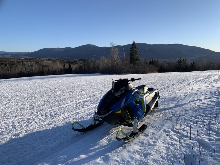 A+snowmobile+is+seen+along+the+scenic+trails+in+Pittsburgh%2C+New+Hampshire%2C+in+2019.