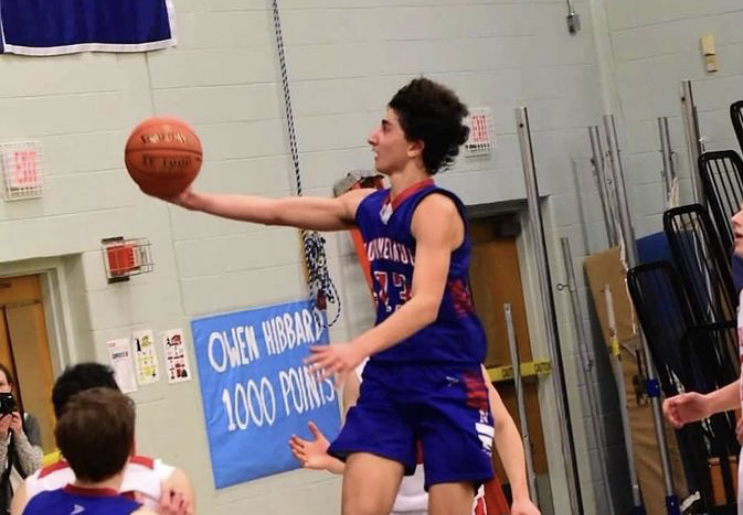 Jon Khazzaka drives for a layup during his junior season.