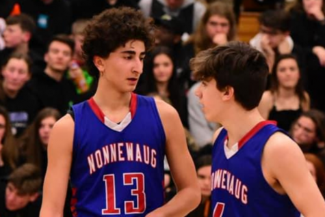Jon Khazzaka (13) and Ryan Tomkalski talk during a basketball game last season. They are two of the Chiefs