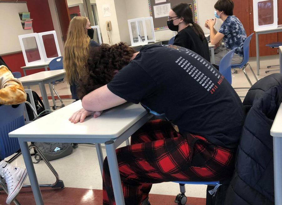 Senior Dan Paganelli rests his head during class March 1. Senioritis commonly affects soon-to-be graduates by the end of the winter.
