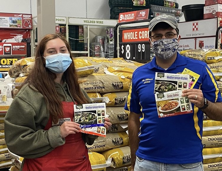 Tom DiMarco, the landscaping teacher at Nonnewaug, picks up a donation of seeds at Tractor Supply Co. in October.