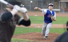 Ryan Tomkalski, NHS senior athlete, pitching at an away game against Thomaston High School on April 13th.