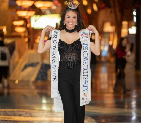 Lindiana Frangu stands at the Mohegan Sun venue with both sashes from her years as Miss Connecticut's Outstanding Teen 2019 and 2020.