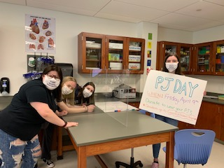 "Science National Honor Society members at NHS make posters to raise awareness for the ""PJ Day"" fundraiser to benefit CT Children"