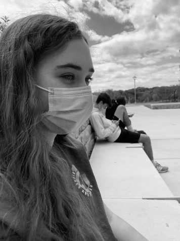 Keira Buckley, a junior, distances herself from her peers during a mask break at NHS.