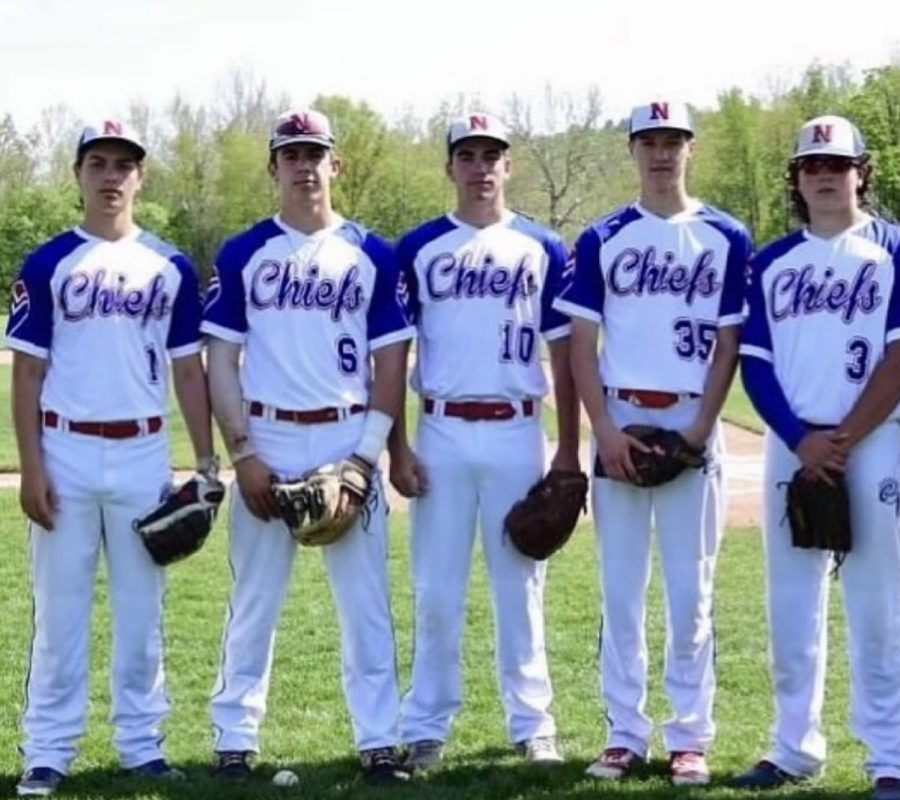 Seniors from the baseball team stand together on Senior Night.