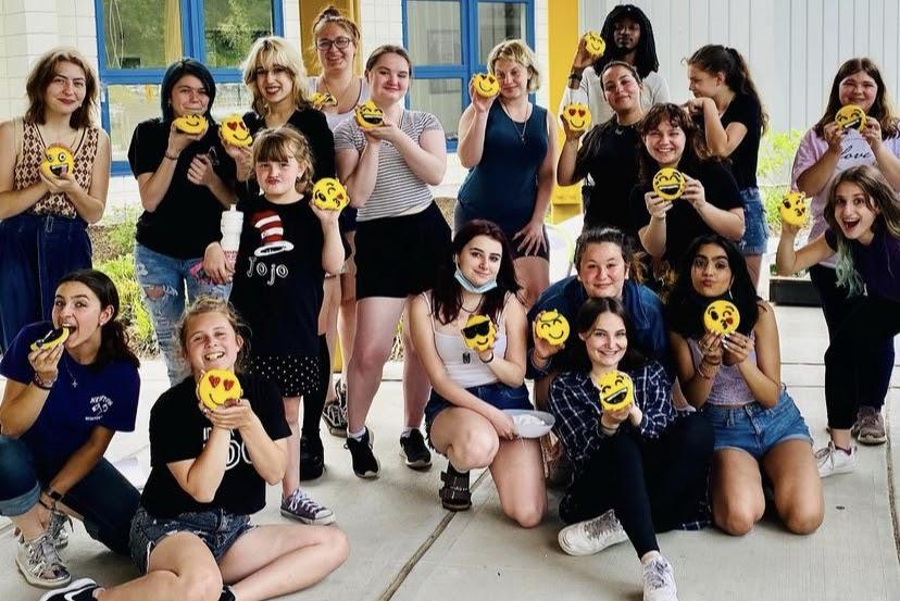 The+Nonnewaug+High+School+drama+club+%28pictured%29+celebrates+their+hard+work+with+some+emoji+cookies.