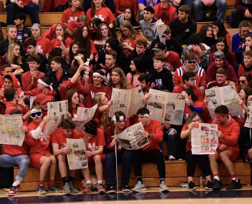 The Nonnewaug High School student section gets hyped up during the red out boys varsity game versus Shepaug High School. This was the rivalry game in March of 2020 just before Covid-19 shut everything down.  (I uploaded this image in the assignment)