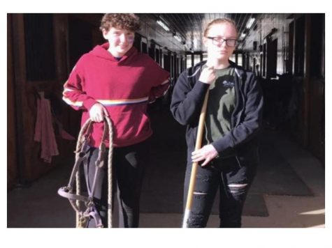 Nonnewaug's Seniors Katrina Fisher and Rachael Garge working towards their SAE hour goal at Hidden Acres Therapeutic Riding Center.